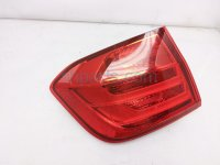 $120 BMW LH TAIL LAMP (ON BODY)