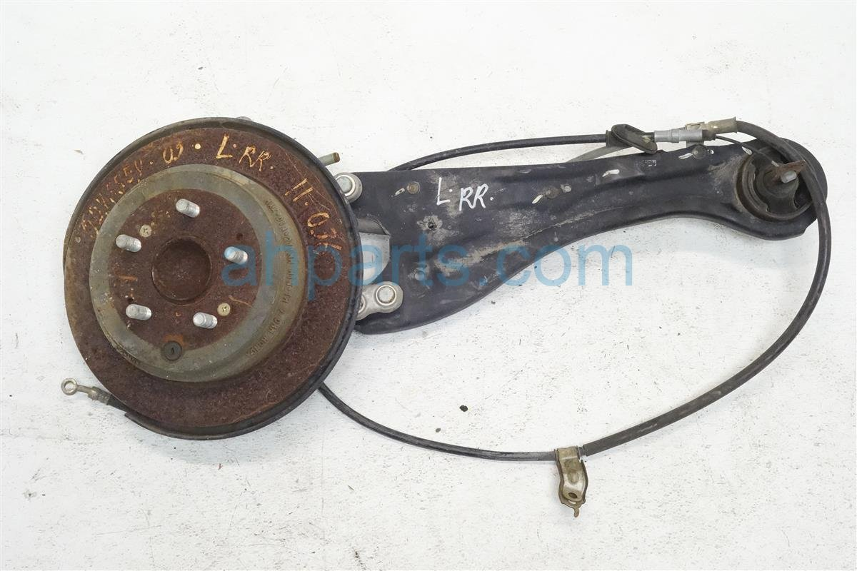 2005 Honda Odyssey Axle stub Rear driver SPINDLE AND TRAILING ARM 52215 SHJ A00 52215SHJA00 Replacement