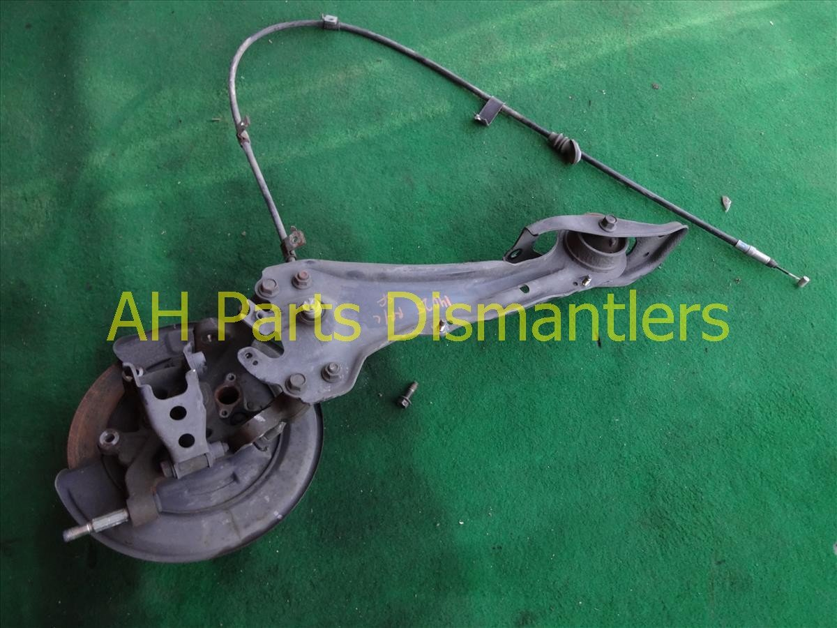 1998 Acura RL Axle stub Rear driver SPINDLE KNUCKLE W TRAILING ARM 52215 SZ3 000 52215SZ3000 Replacement